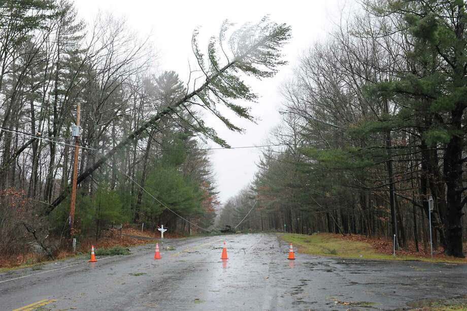 Trees and wires came down during a wind and rain storm and caused part of Rt. 66 to close near Crystal Lake Road on Friday Dec. 21, 2012 in Averill Park, N.Y.  (Lori Van Buren / Times Union) Photo: Lori Van Buren