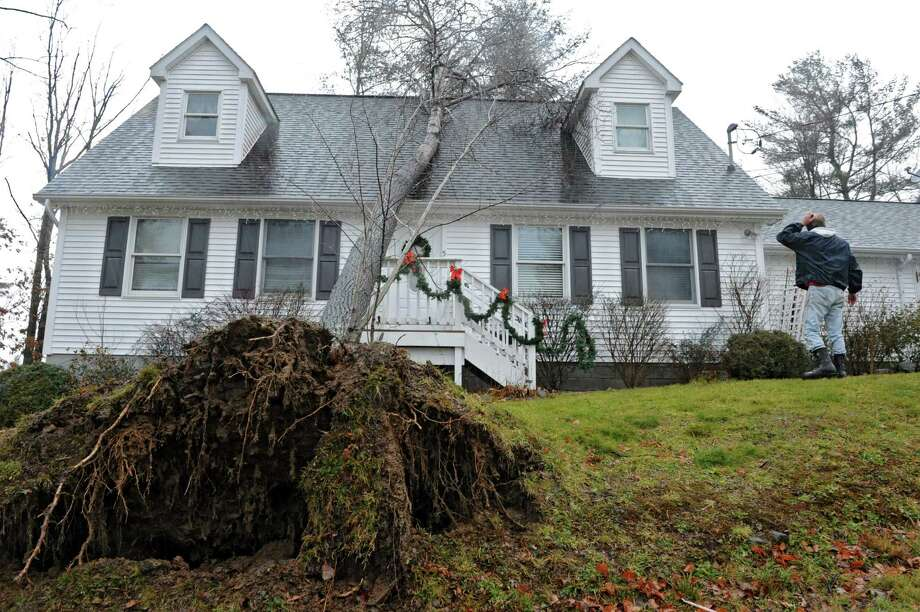 Friday?s strong winds uprooted this tree which landed on home at 5 Allen Avenue in Averill Park, N.Y., Dec. 21, 2012. Wind damage was prevalent throughout Rensselaer County and the Capital Region. (Lori Van Buren / Times Union) Photo: Lori Van Buren
