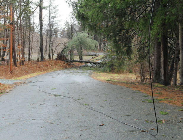 Part of a road is closed due to a down wire and tree from high winds and rain on Friday Dec. 21, 2012 in West Sand Lake, N.Y.  (Lori Van Buren / Times Union) Photo: Lori Van Buren