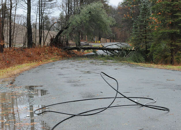 Part of Springer Rd is closed due to a down wire and tree from high winds and rain on Friday Dec. 21, 2012 in West Sand Lake, N.Y.  (Lori Van Buren / Times Union) Photo: Lori Van Buren