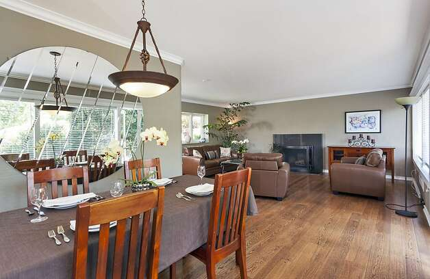 The dining room, with the living room in the background. Photo: Scott Hargis/SF