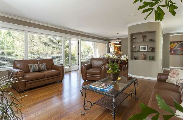 Large windows provide views of a lush garden. Photo: Scott Hargis/SF