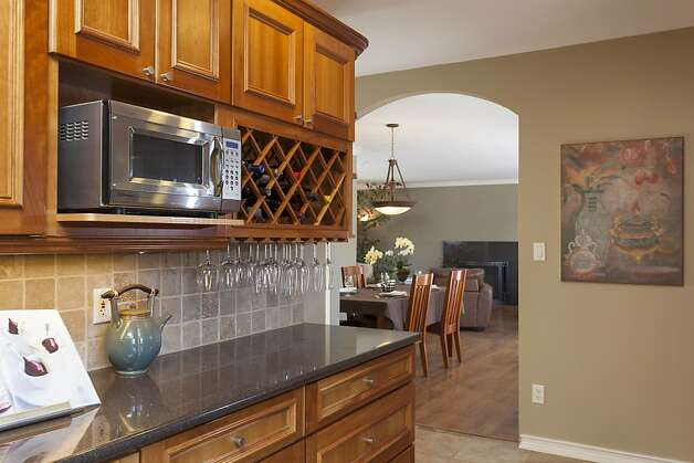 Stainless steel appliances and abundant storage space are features of the chef's kitchen. Photo: Scott Hargis/SF