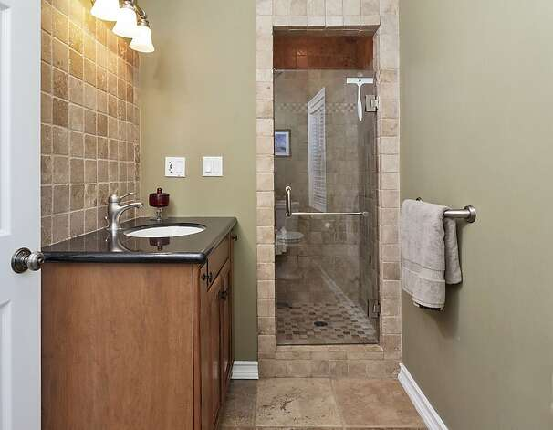 The master bathroom comes with a tile shower. Photo: Scott Hargis/SF