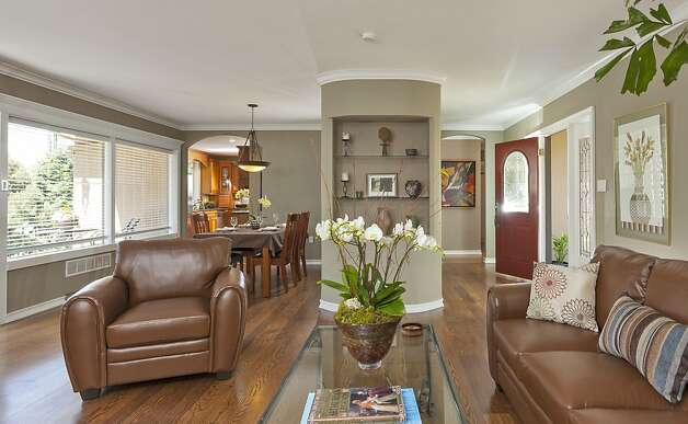 Hardwood floors decorate the living room, dining room and foyer. Photo: Scott Hargis/SF
