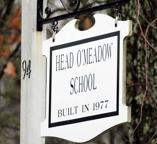 Head O'Meadow Elementary School in Newtown stayed closed Tuesday after a mysterious threat, four days after a gunman killed 26 people at the Sandy Hook Elementary School. Photo: Carol Kaliff / The News-Times