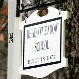 Head O'Meadow Elementary School in Newtown stayed closed Tuesday after a mysterious threat, four days after a gunman killed 26 people at the Sandy Hook Elementary School.