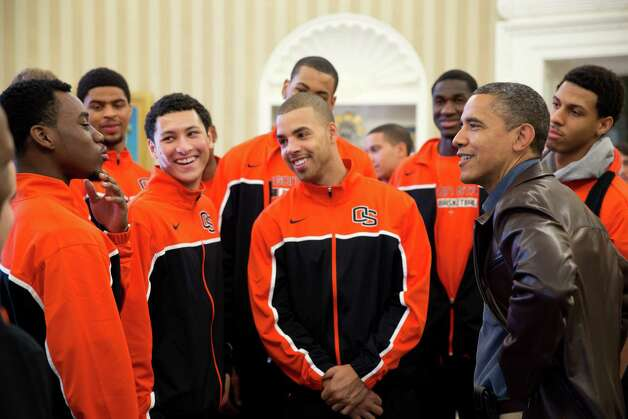 President Barack Obama jokes with Oregon State's players during the Beavers' visit to the Oval Office in the White House on Thanksgiving Day. The team's coach is Craig Robinson (below), who is the brother of first lady Michelle Obama. Photo: PETE SOUZA, AFP/Getty Images / This official White House photograph is being made available only for publication by news organizations and/or for personal use