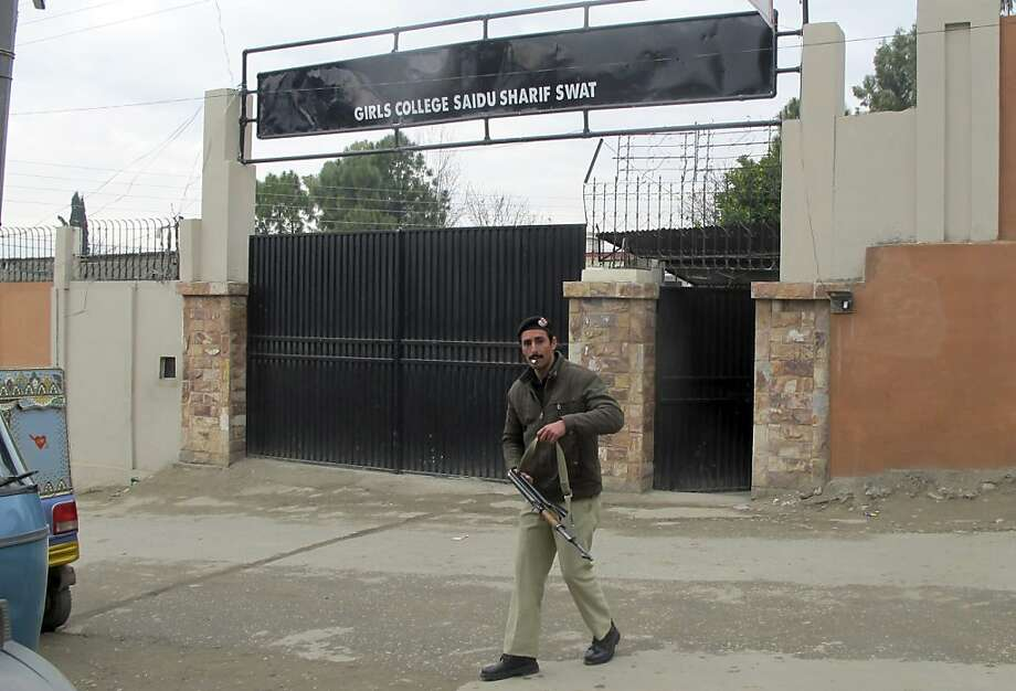 A Pakistani police officer stands guard outside the college that was named after Malala Yousufzai, who was shot and injured by the Taliban. Photo: Sherin Zada, Associated Press