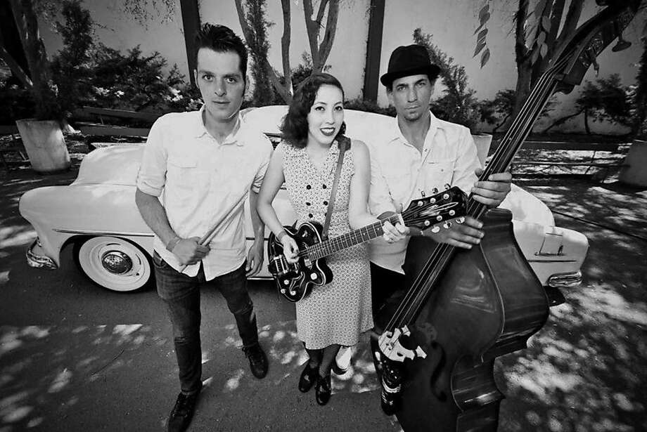 Scott Springer, Summer Murase and Tony Velour make up the band Rocketship Rocketship, which was formed in 2010. They play dance music with a dash of surf rock. Photo: Nick Koljian