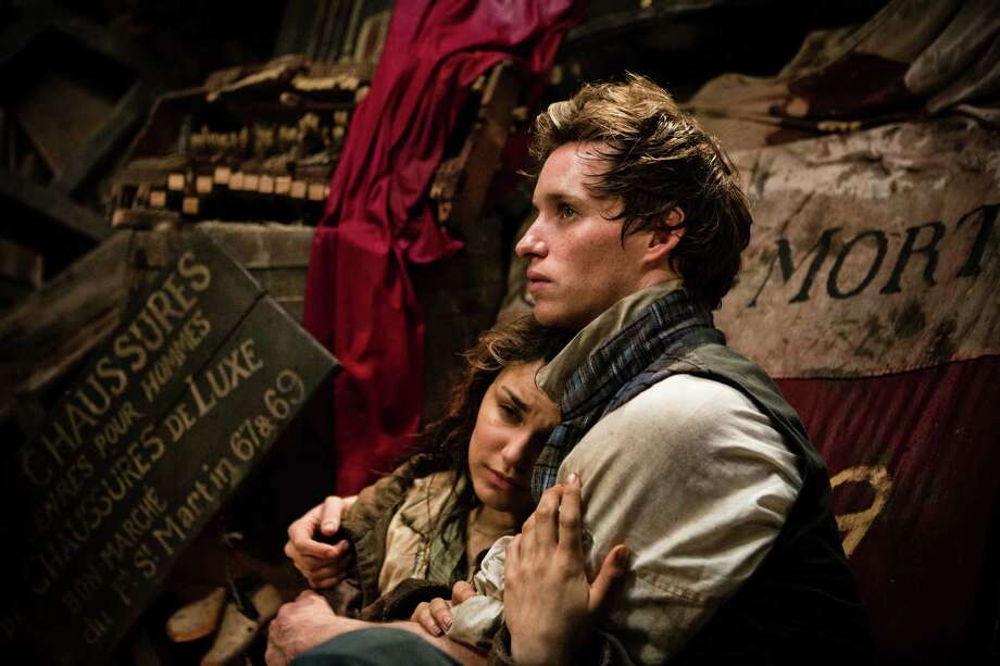 """Éponine (SAMANTHA BARKS) seeks comfort from Marius (EDDIE REDMAYNE) in """"Les Misérables"""", the motion-picture adaptation of the beloved global stage sensation seen by more than 60 million people in 42 countries and in 21 languages around the globe and still breaking box-office records everywhere in its 28th year. / Copyright: © 2012 Universal Studios. ALL RIGHTS RESERVED."""