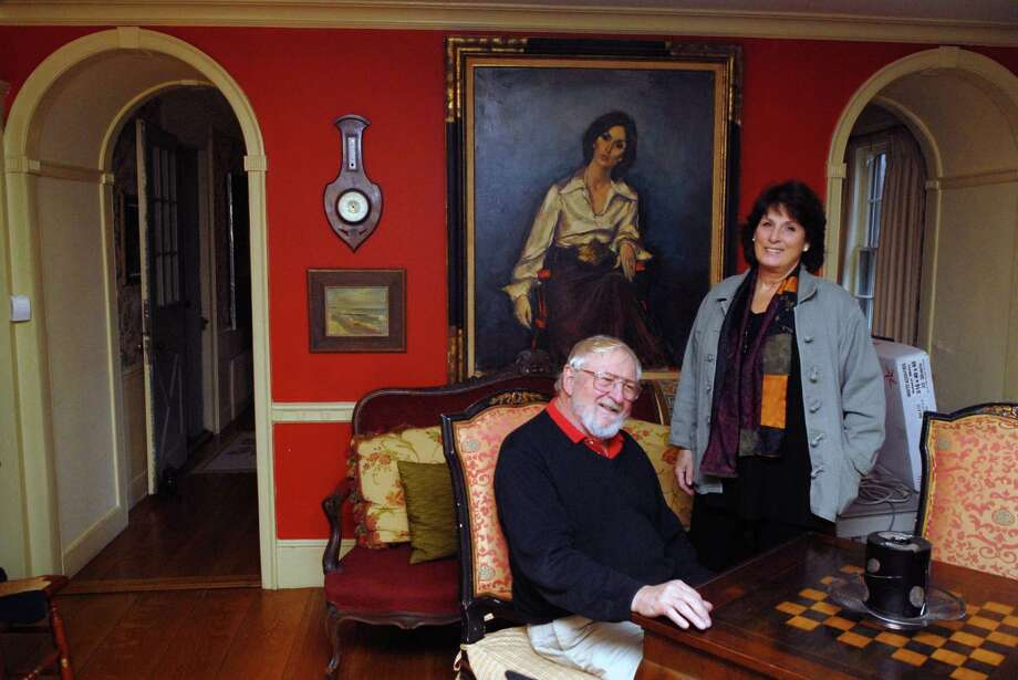 Kenneth and Elizabeth Lange at home in Stamford, Conn. on Friday December 21. 2012, behind them is a portrait of Elizabeth done by Jan DeRuth who had also painted a portrait of Jackie Kennedy. Photo: Dru Nadler / Stamford Advocate Freelance