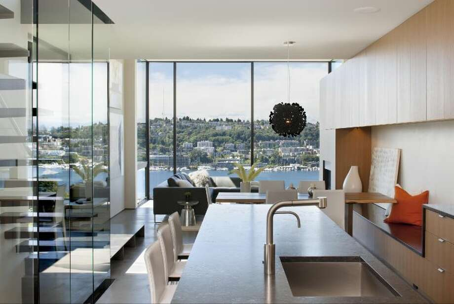 Kitchen of 814 E. Blaine St., has two bedrooms, 1.75 bathrooms, concrete floors, a floating staircase, walls of windows and a view deck looking over Lake Union. It's listed for $1.5 million. Photo: Courtesy Sandra Pappas/Windermere Real Estate