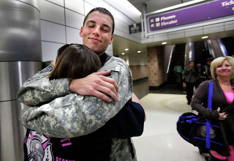 U.S. Army Pfc Shawn Walter gives his mother, Shannan Walter, a bear hug after arriving at the San Antonio International Airport from Fort Bragg, for the holidays, Dec. 21, 2012 Photo: Bob Owen, San Antonio Express-News / ©SAN ANTONIO EXPRESS-NEWS