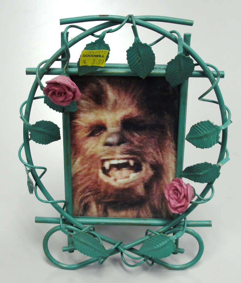This may be the best last second gift idea ever. Unfortunately, it is a unique piece. Though similar custom frame art can be found at most thrift stores and Christmas Eve garage sales.