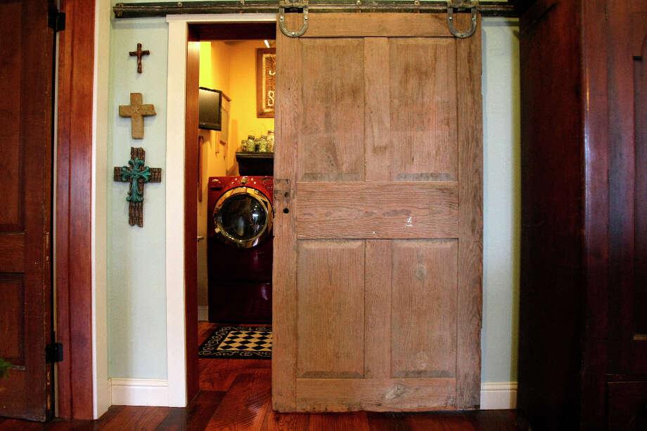 Leo and Karen Scherrer have made use of antique doors throughout their New Braunfels home. Photo: Helen L. Montoya, San Antonio Express-News / ©SAN ANTONIO EXPRESS-NEWS