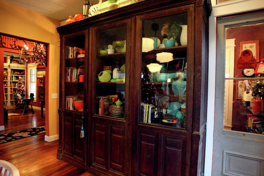 Created from old French phone booths this pieces sits in the kitchen of Leo and Karen Scherrer's  home in New Braunfels. Photo: Helen L. Montoya, San Antonio Express-News / ©SAN ANTONIO EXPRESS-NEWS