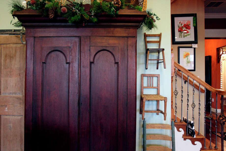 Living room armoire. Photo: Helen L. Montoya, San Antonio Express-News / ©SAN ANTONIO EXPRESS-NEWS