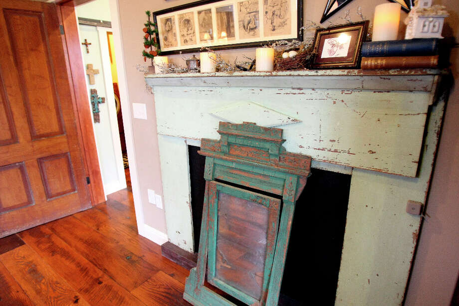 Faux fire places were crafted by Leo Scherrer as he and his wife Karen did not want real fireplaces, but wanted look of fireplaces in the home. Photo: Helen L. Montoya, San Antonio Express-News / ©SAN ANTONIO EXPRESS-NEWS