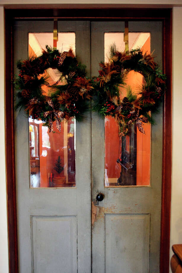 Leo and Karen Scherrer have made use of antique doors throughout their New Braunfels home. Photo: Helen L. Montoya, San Antonio Express-News / ©SAN ANTONIO EXPRESS-NEWS