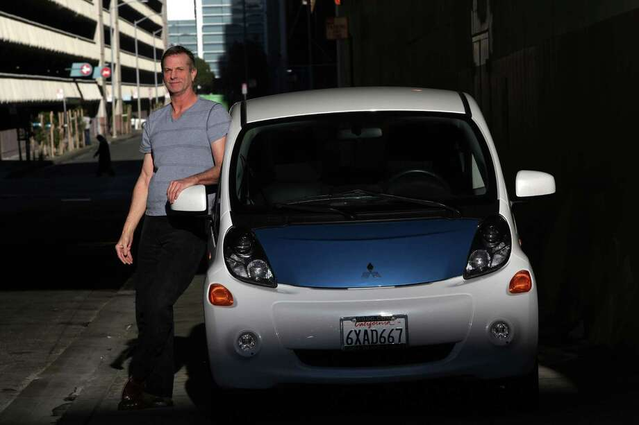 Bill Gravitt from San Francisco showing his Mitsubishi electric car in San Francisco, California, on Wednesday,  December 19, 2012. Photo: Liz Hafalia, Staff / SFC