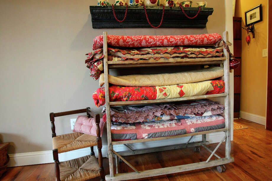 Stacks of quilts in a guest room in the Scherrer's  home in New Braunfels. Photo: Helen L. Montoya, San Antonio Express-News / ©SAN ANTONIO EXPRESS-NEWS