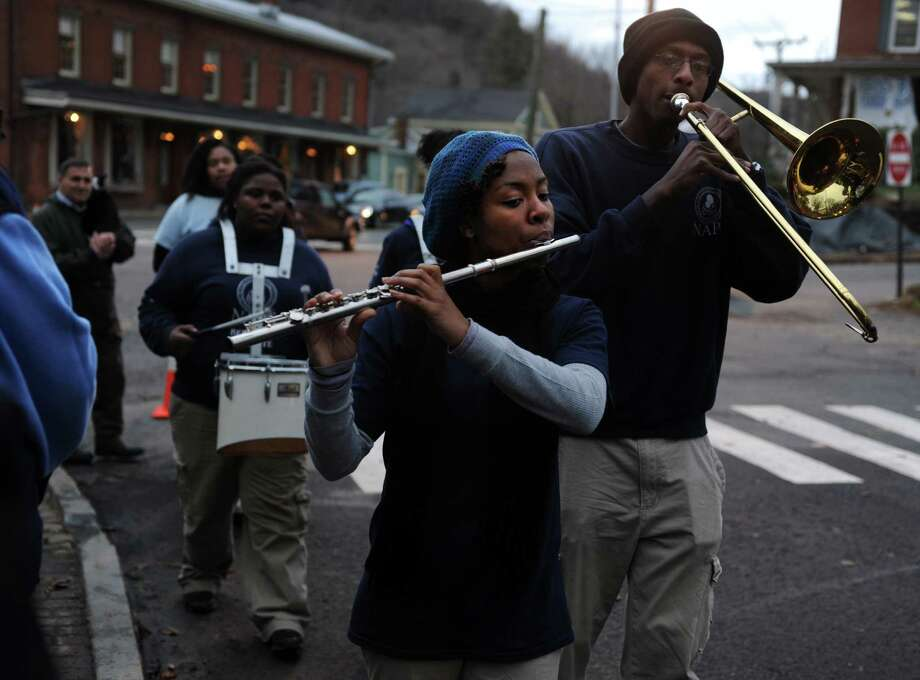 "Kahryl Bennett and Christopher Holloway, youth volunteers from Huntsville, AL, play ""Amazing Grace"" in front of a memorial for the victims of the Sandy Hook Elementary School shooting in Newtown, Conn. Friday, Dec. 21, 2012 Photo: Autumn Driscoll / Connecticut Post"
