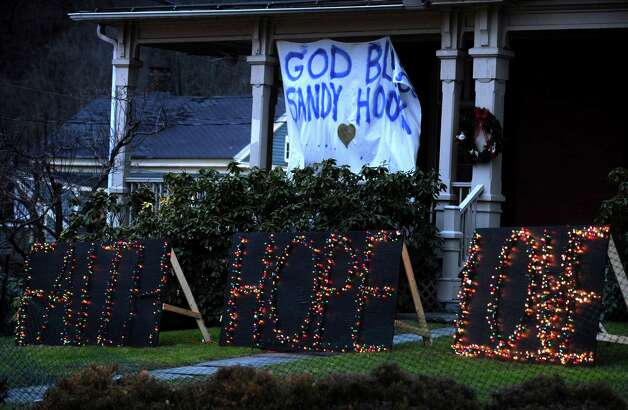 A sign in the Sandy Hook neighborhood of Newtown, Conn. Friday, Dec. 21, 2012 near a memorial for the victims of the Sandy Hook Elementary School shooting. Photo: Autumn Driscoll / Connecticut Post