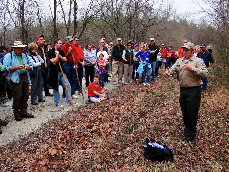 This Jan. 1, 2012 photo provided by the Virginia State Parks and the Department of Conservation and Recreation shows Virginia State Parks ranger Bob Flippen, right, at Virginia's High Bridge Trail State Park leading a group of hikers on a First Day Hike in Va. The hike was one of 400 First Day Hikes held at state parks last Jan. 1. More than 600 are planned for this Jan. 1. (AP Photo/Virginia Department of Conservation and Recreation) Photo: Associated Press / Virginia Department of Conservat