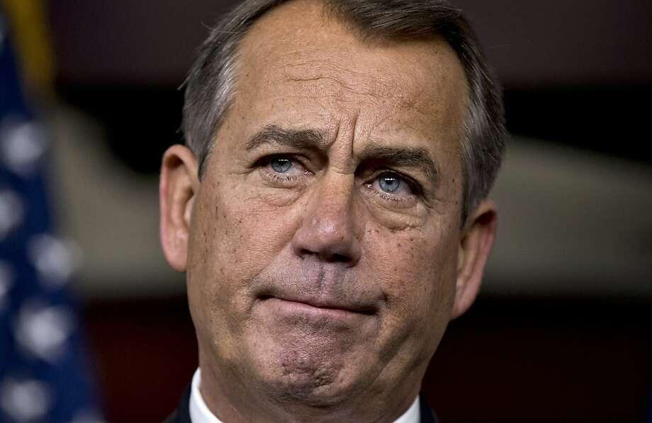 House Speaker John Boehner will cut his holiday break short. Photo: J. Scott Applewhite, Associated Press