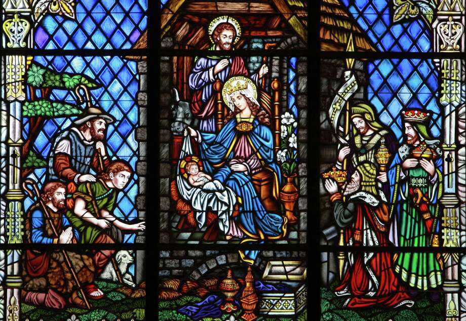 Detail of the stained-glass Nativity scene at the front of the sanctuary at Our Lady of Walsingham Catholic Church in Houston. Photo: Gary Fountain, Freelance / Freelance