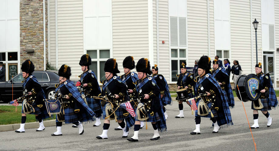 Members of the New York Port Authority Police Pipes and Drum Corps. line up to play during a funeral service for Dylan Hockley Friday. The funeral service for Dylan Hockley, victim of the Sandy Hook Elementary School shootings last week, was held at Walnut Hill Community Church in Bethel, Conn. Friday, Dec. 21, 2012. Photo: Carol Kaliff / The News-Times