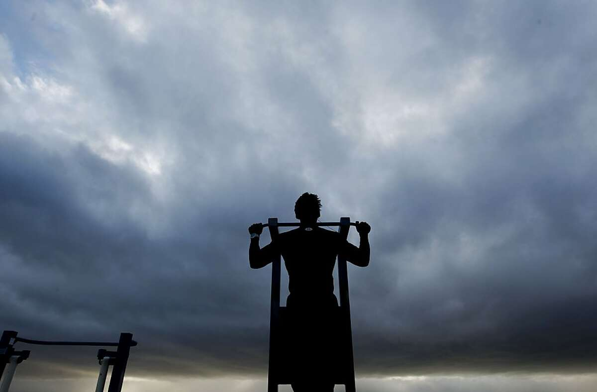 A Pastor and a physical trainer Joseph Keppard works out before the next rain rolls in across the Bay at the San Leandro Marina, as a series of storms are lined up off the coast on Friday Dec. 21,2012.