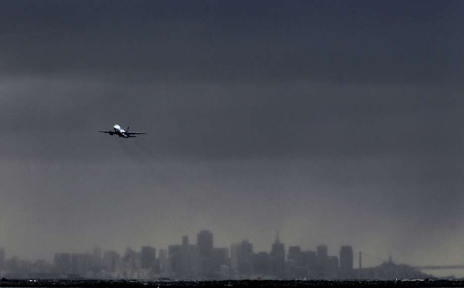 Planes take off from Oakland International Airport as a series of rain storms are lined up and on their way  on Friday Dec. 21,2012. Photo: Michael Macor, The Chronicle