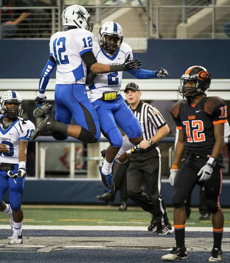 Navasota's Austin Collins (2) celebrates with Solomon McGinty (12) after scoring on a  51-yard pass during the first half. Photo: Smiley N. Pool, Houston Chronicle / © 2012  Houston Chronicle