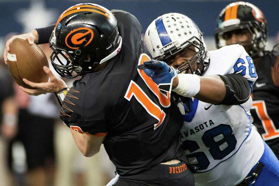 Gilmer quarterback Tanner Barr (10) is sacked by  Navasota's Jordan Wells (68) during the first half. Photo: Smiley N. Pool, Houston Chronicle / © 2012  Houston Chronicle