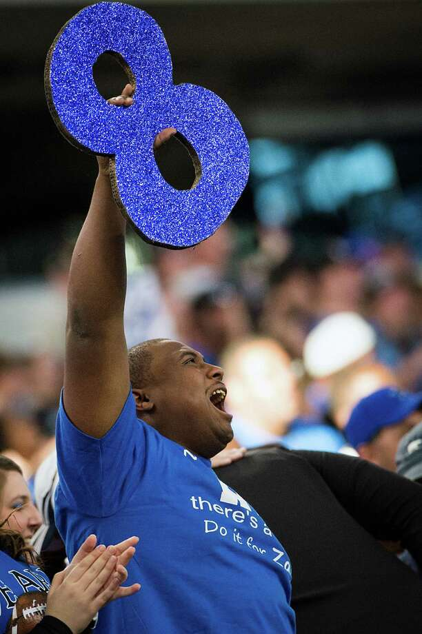 Fans hold up #8 signs in support of Navasota's Xavier Creeks during the first half.  Creeks, the leading rusher for the Rattlers, was injured in a car accident on Thursday. Photo: Smiley N. Pool, Houston Chronicle / © 2012  Houston Chronicle