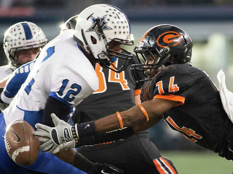 Gilmer's De Thomas (14) reaches for a loose ball after a blocked extra point attempt as Navasota's Solomon McGinty (12) prepares to make a hit. Photo: Smiley N. Pool, Houston Chronicle / © 2012  Houston Chronicle