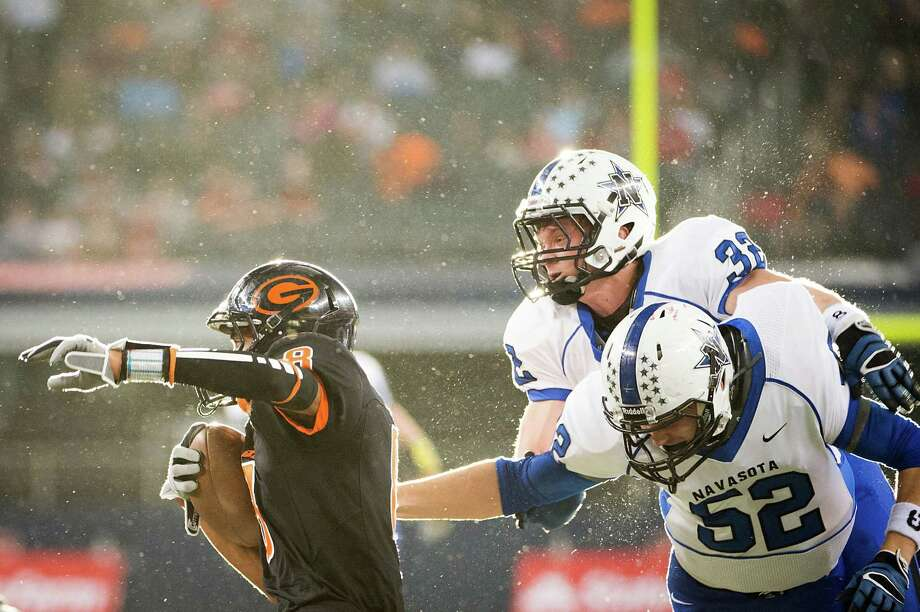 Gilmer's Trey Washington (8) is brought down  by Navasota's Dustin Savensky (52) and Jake Bauer (32) during the first half of the Class 3A Division II state championship football game at Cowboys Stadium. Photo: Smiley N. Pool, Houston Chronicle / © 2012  Houston Chronicle