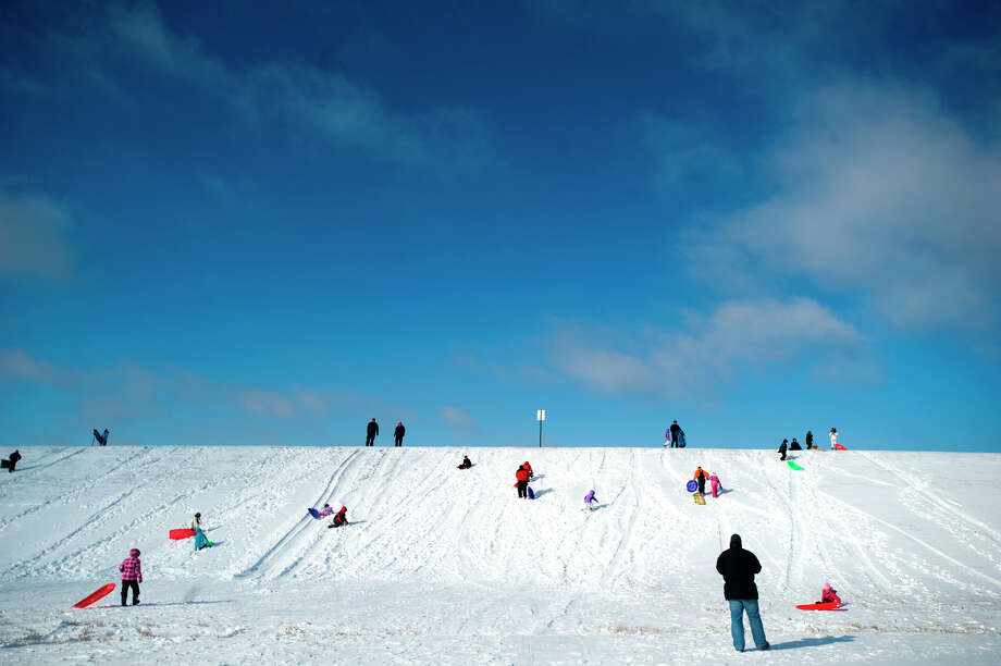Sledders enjoy the snow on Thursday, Dec. 20, 2012 at Holmes Lake in Lincoln, Neb. Photo: Adam Wolffbrandt, MBI / The Journal-Star