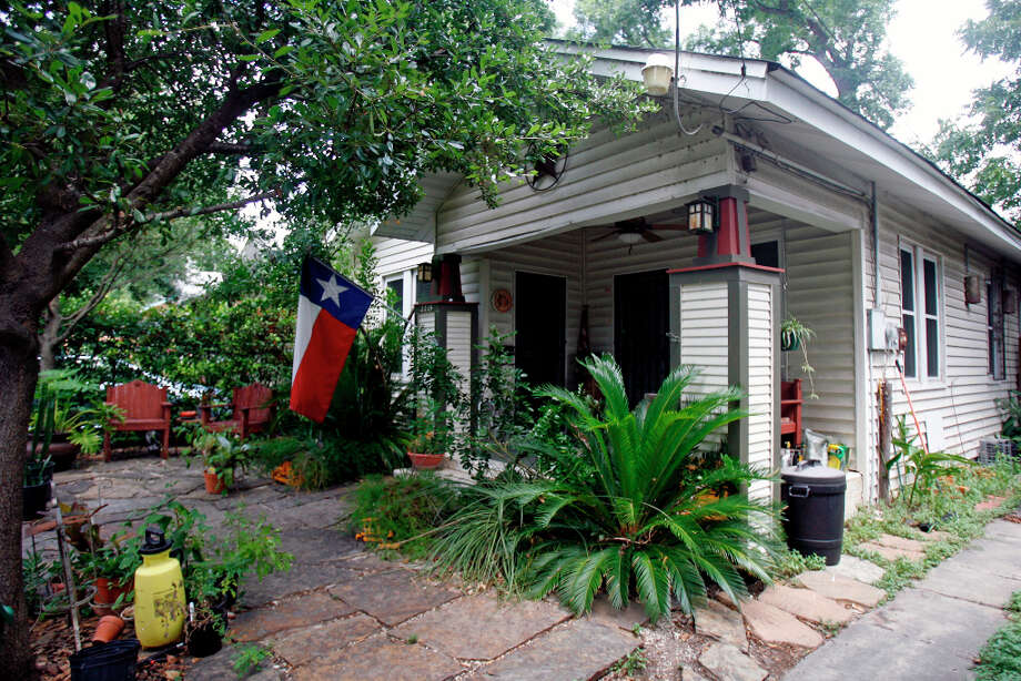 Joe Carreon, owner of his grandparent's Craftsman-style home in Prospect Hill, would like to replace the front doors. Photo: SARA M. STRICK, San Antonio Express-News / SSTRICK@express-news.net