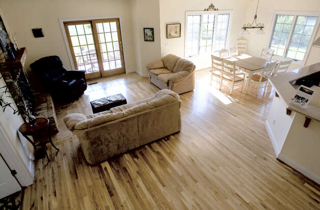 Dan and Elizabeth Guinn used hardwood and recycled tiles on the floor for all but one room upstairs in their green house in Yorktown, Virginia. Photo: Joe Fudge, MCT / Newport News Daily Press