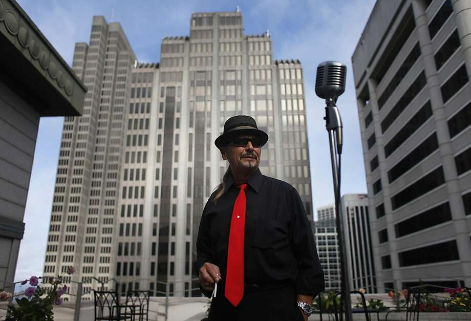 Jack Luna, on the rooftop of the Mechanics Bank in 2011, played a gig there in November and died two weeks later. Photo: Mike Kepka, The Chronicle