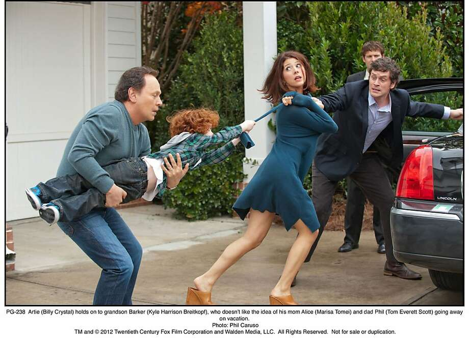 Artie (Billy Crystal) tries to control a grandson (Kyle Harrison Breitkopf) whose parents (Marisa Tomei, Tom Everett Scott) take off. Photo: Phil Caruso, Twentieth Century Fox