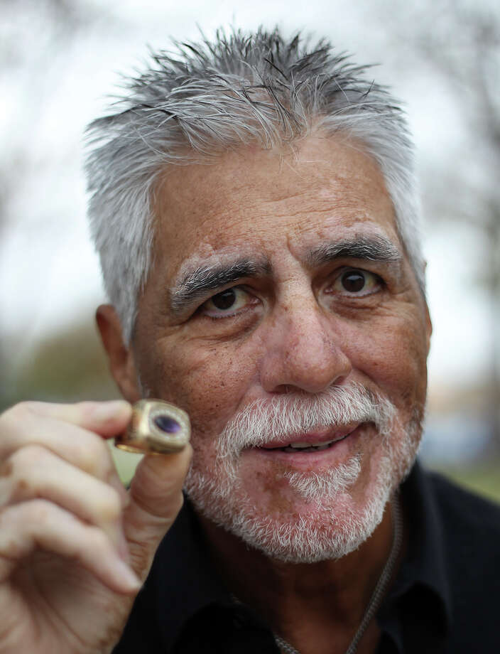 Vic Castillo played quarterback on the 1962 Brackenridge High School football team that captured the 4A state championship crown. He holds a ring to commemorate the victory. Photo: Kin Man Hui, San Antonio Express-News / ©2012 San Antonio Express-News