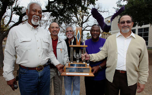 In 1962, Brackenridge High School won the 4A state championship in football. Some of the members of that winning team are: Claudus Minor (from left), Johnny Pesina, Vic Castillo, Robert Wade and Ejidio Villarreal. They are celebrating the 50th anniversary of that historic victory. Photo: Kin Man Hui, San Antonio Express-News / ©2012 San Antonio Express-News