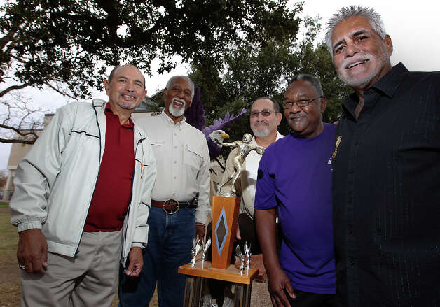 In 1962, Brackenridge High School won the 4A state championship in football. Some of the members of that winning team are: Johnny Pesina (from left), Claudus Minor, Ejidio Villarreal, Robert Wade and Vic Castillo. They are celebrating the 50th anniversary of that historic victory. Photo: Kin Man Hui, San Antonio Express-News / ©2012 San Antonio Express-News