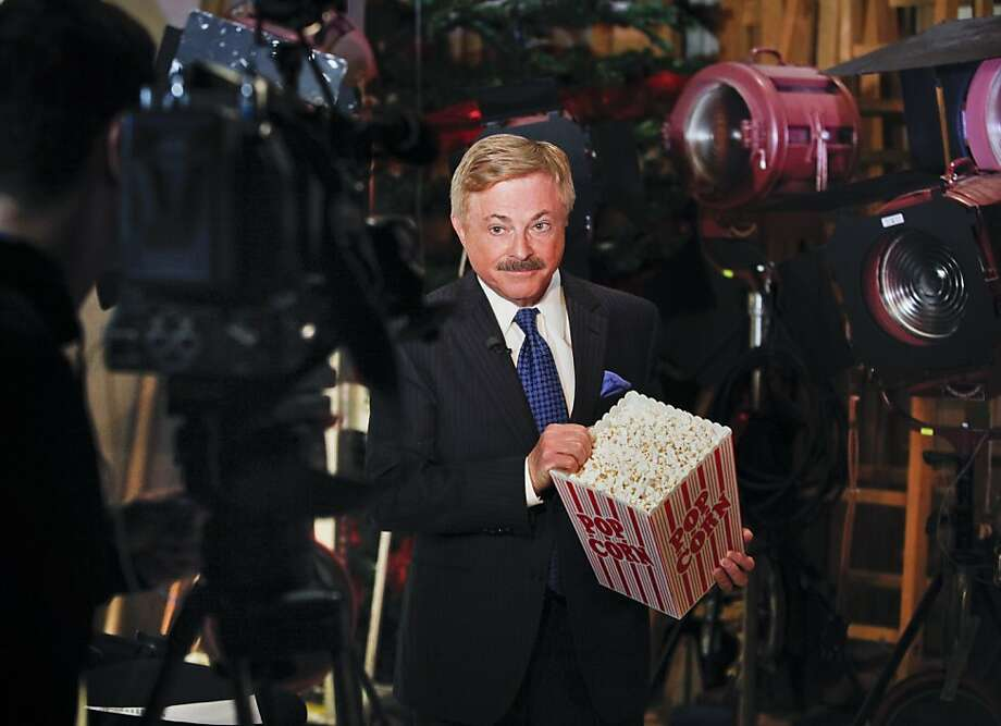 Don Sanchez, who has retired after 40 years in television, holds his popcorn bucket. Photo: Russell Yip, The Chronicle
