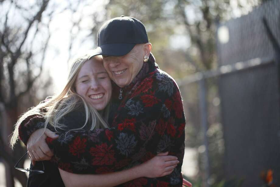 "Anne Baldwin, a Season of Sharing recipient who has been diagnosed with terminal breast cancer, hugs her 15-year-old daughter, Courtney, whom Baldwin calls ""my pride and joy."" Photo: Mike Kepka, The Chronicle"