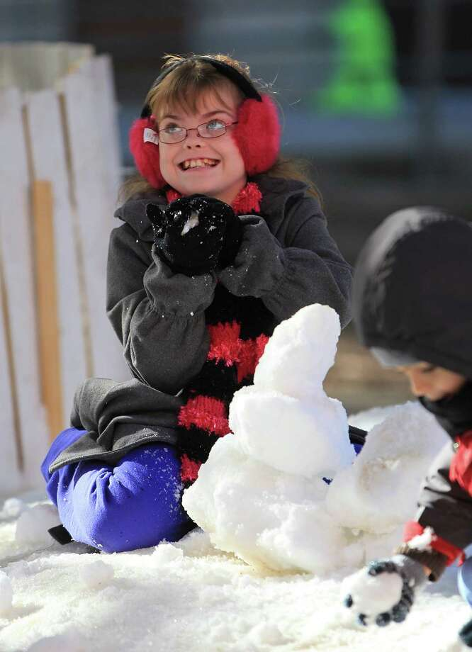 Addie Gilchrist, 10, makes a snowman during Be An Angel Fund's 21st Annual Snow Day at T.H Rogers School. Photo: Karen Warren, Houston Chronicle / © 2012 Houston Chronicle